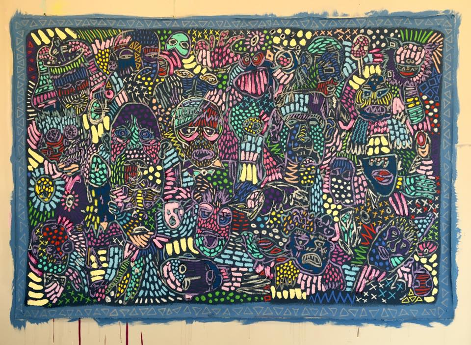 A piece of artwork with lots of colourful faces