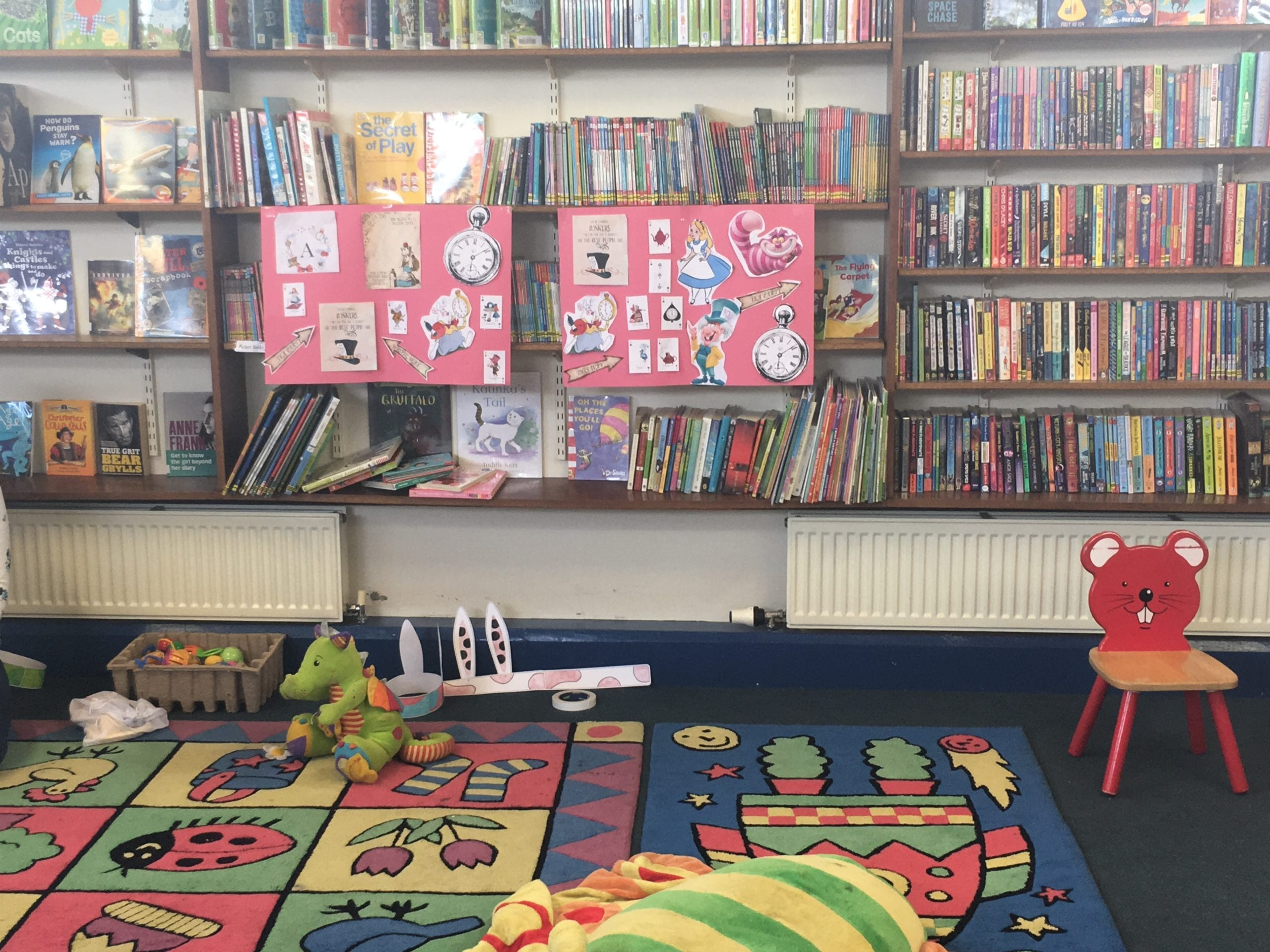 A play area in a library with an Alice in Wonderland display