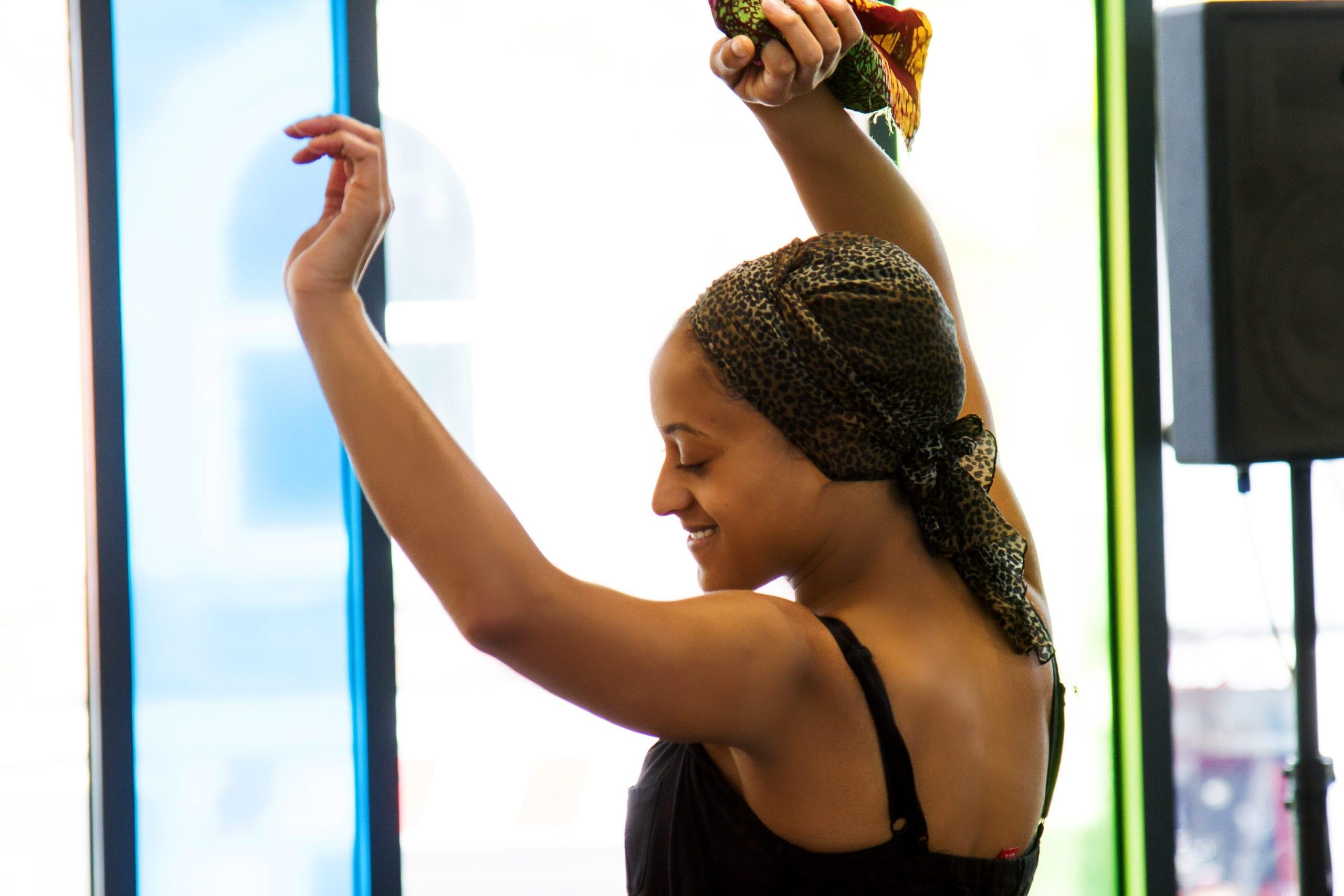 A woman dancing at a Lyrici Arts event