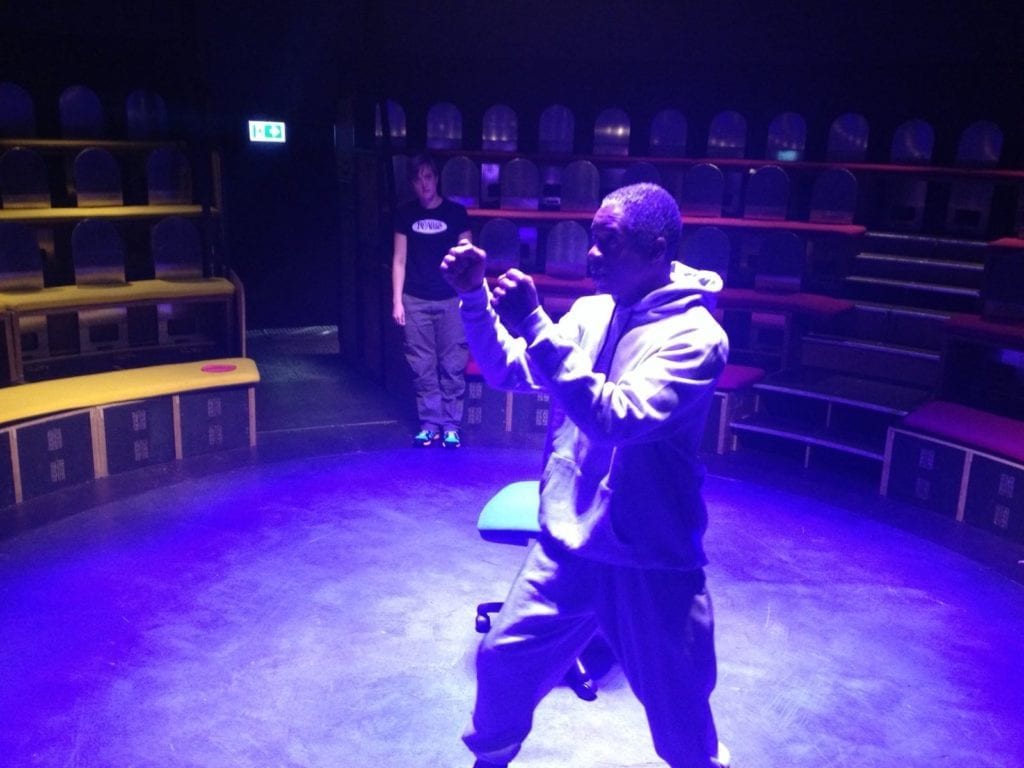 A male actor rehearsing for a performance