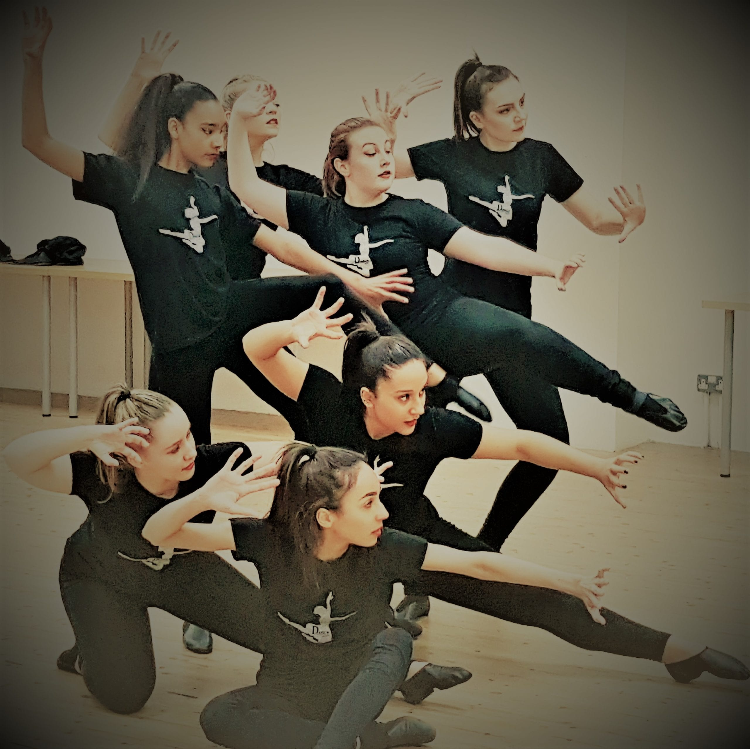 A group of young female dancers dressed in black