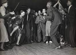 Harlem rent parties with black people dancing